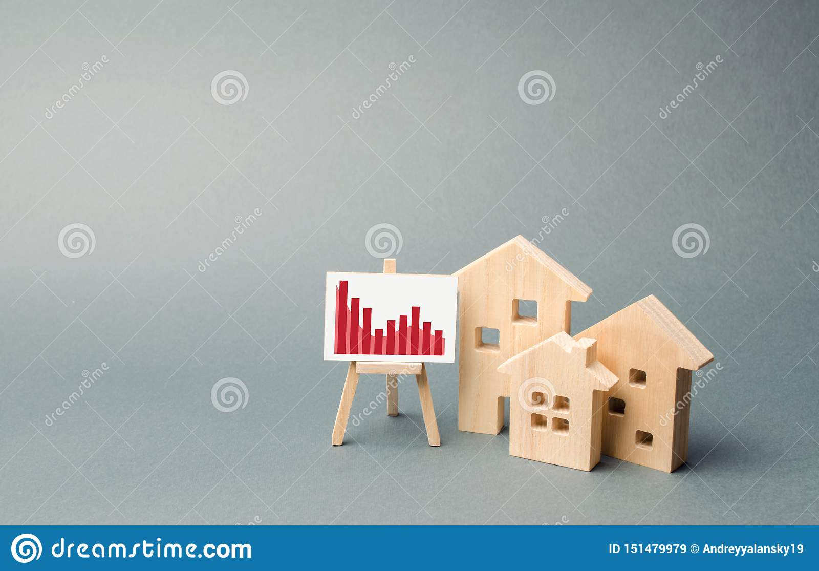 Wooden Houses With A Stand Of Graphics And Information Concept Of