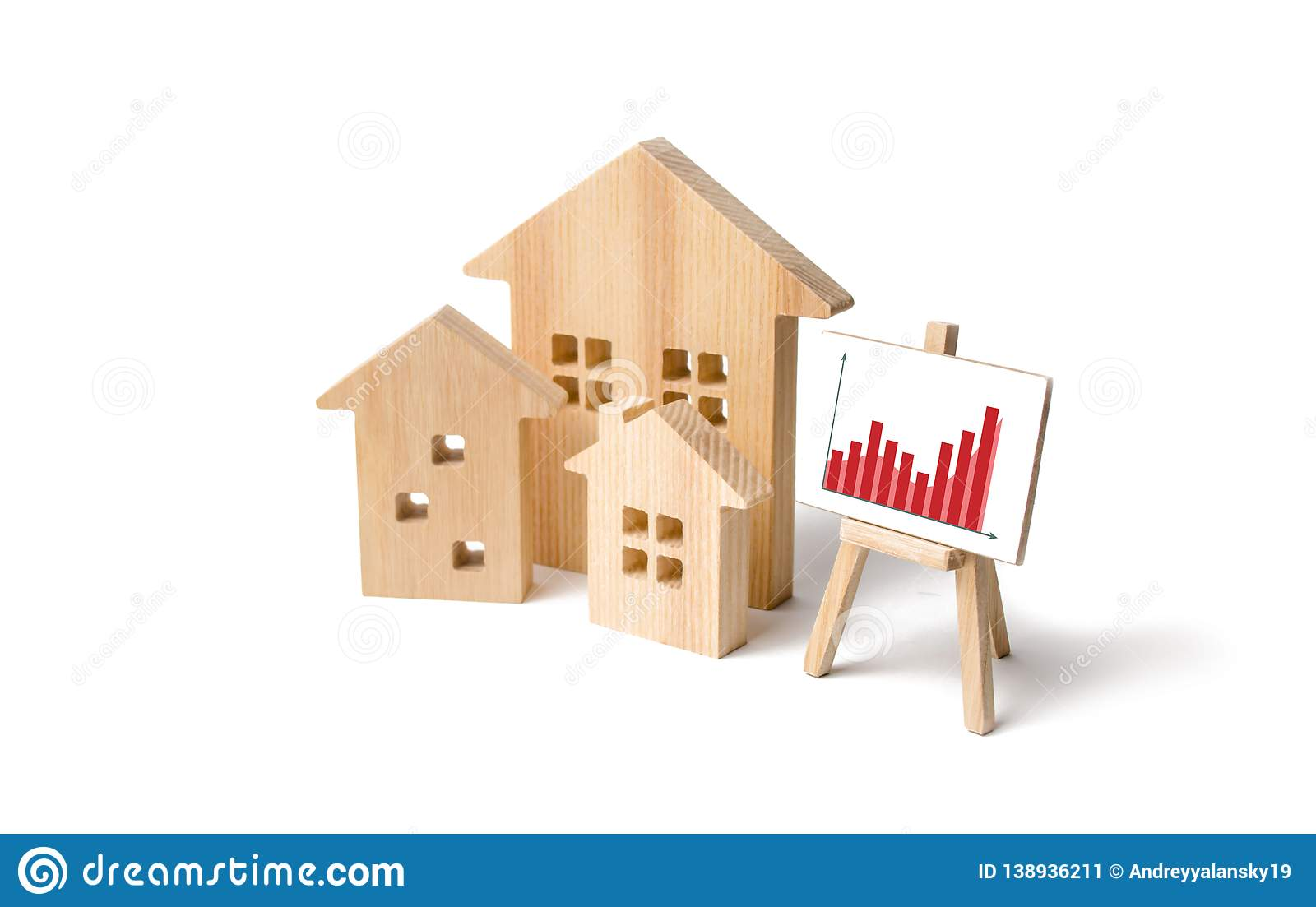 Wooden houses with a stand of graphics and information. Growing demand for housing and real estate. growth of the city