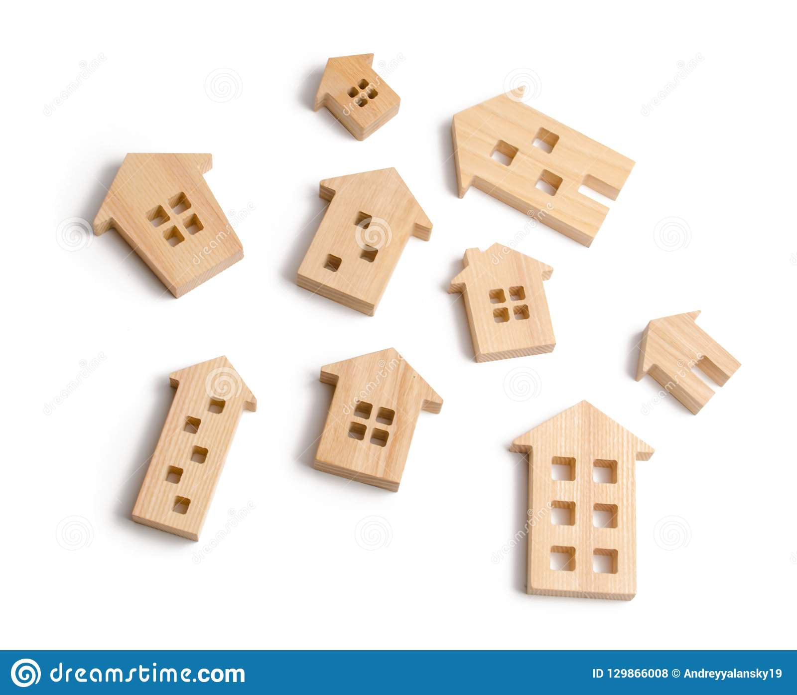 Wooden houses on a white background. The concept of rising prices for housing or rent. Growing demand for housing and real estate.