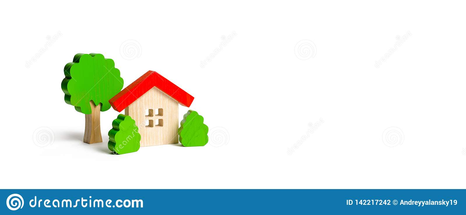 Wooden hut and tree figurines with bushes on an isolated background. The concept of a love nest. Acquisition of affordable housing