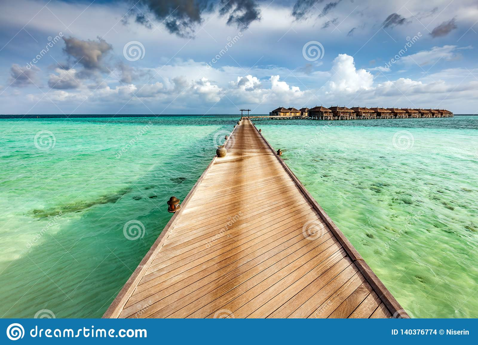 Wooden jetty on the ocean on Maldives Islands