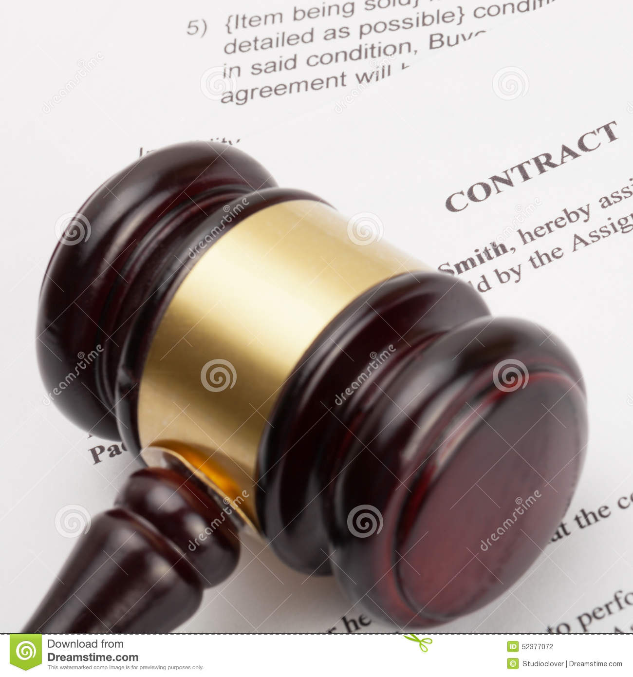 Wooden judge s gavel and contract - close up shot