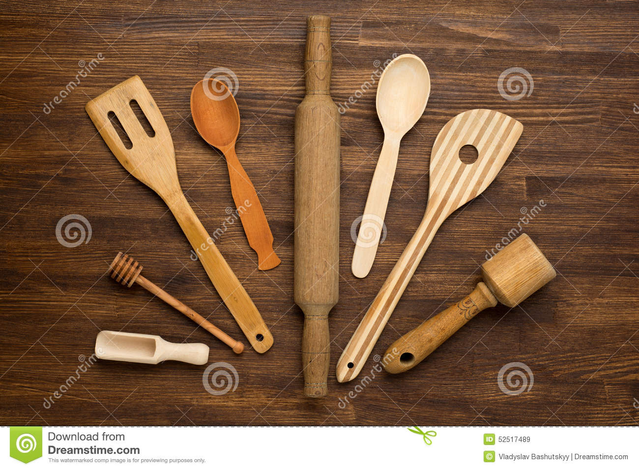 wooden kitchen tools on vintage wooden background stock