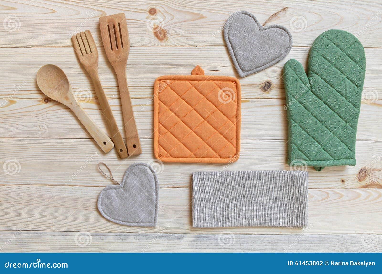 Wooden kitchen utensils potholder glove and napkin stock for Table utensils