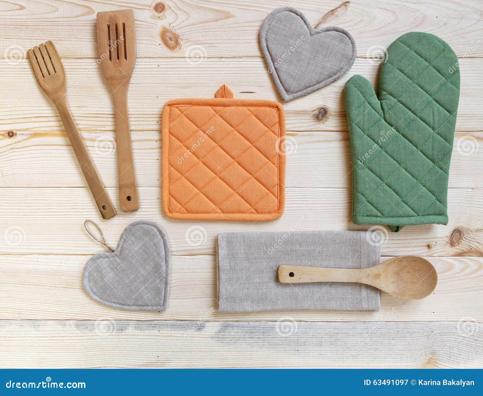 Wooden kitchen utensils potholder glove and napkin on for Table utensils