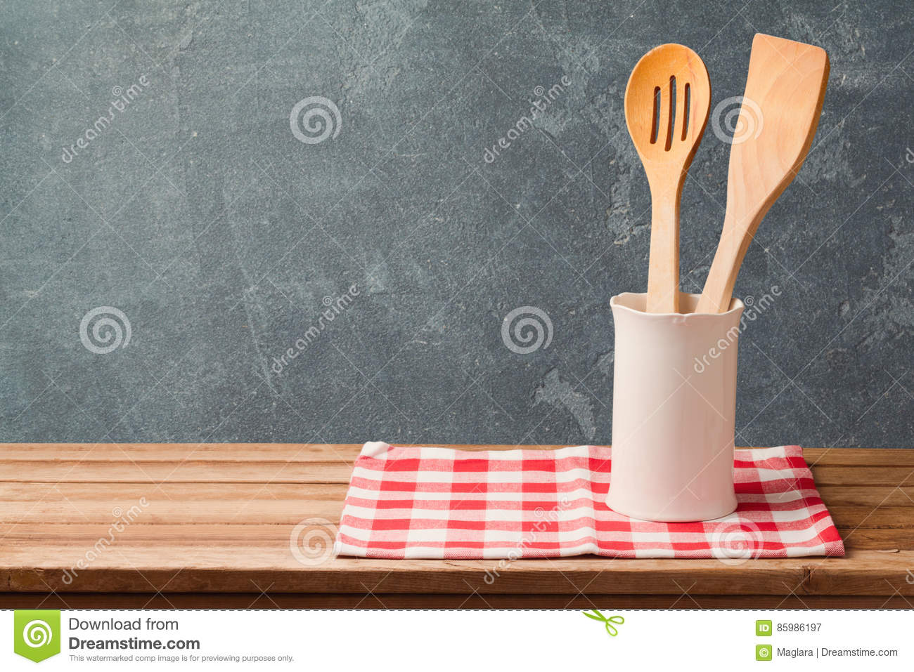 Wooden Kitchen Utensils On Table With Tablecloth Over