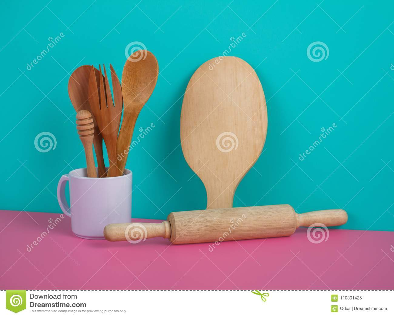 Wooden Kitchen Utensils In White Mug, Rolling Pin, And Cutting B ...