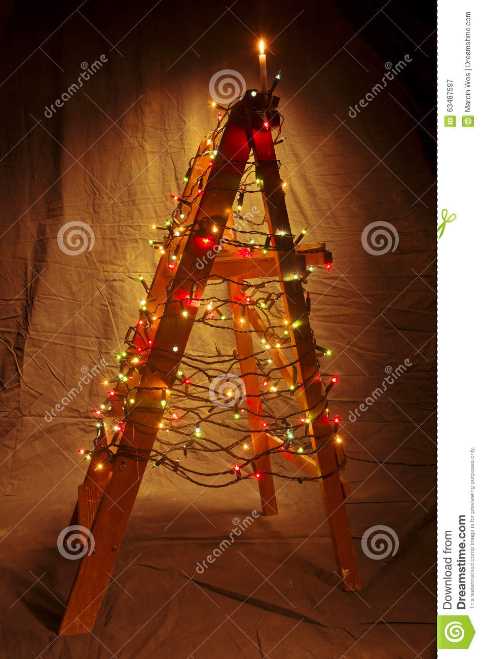 the wooden ladder decorated with christmas lights the shape of