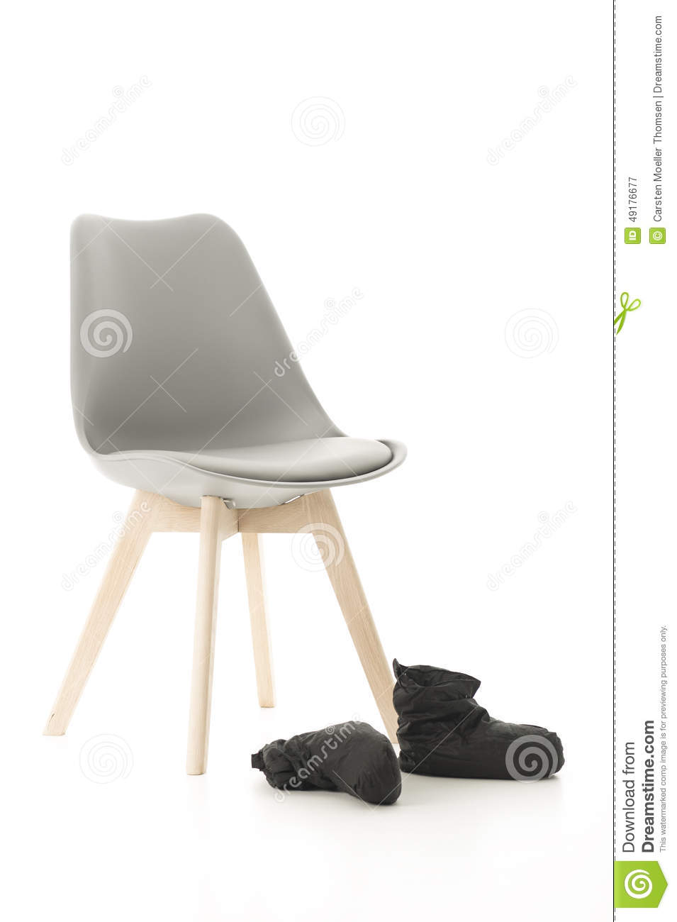 Wooden Leg Chair and Black Boots on White