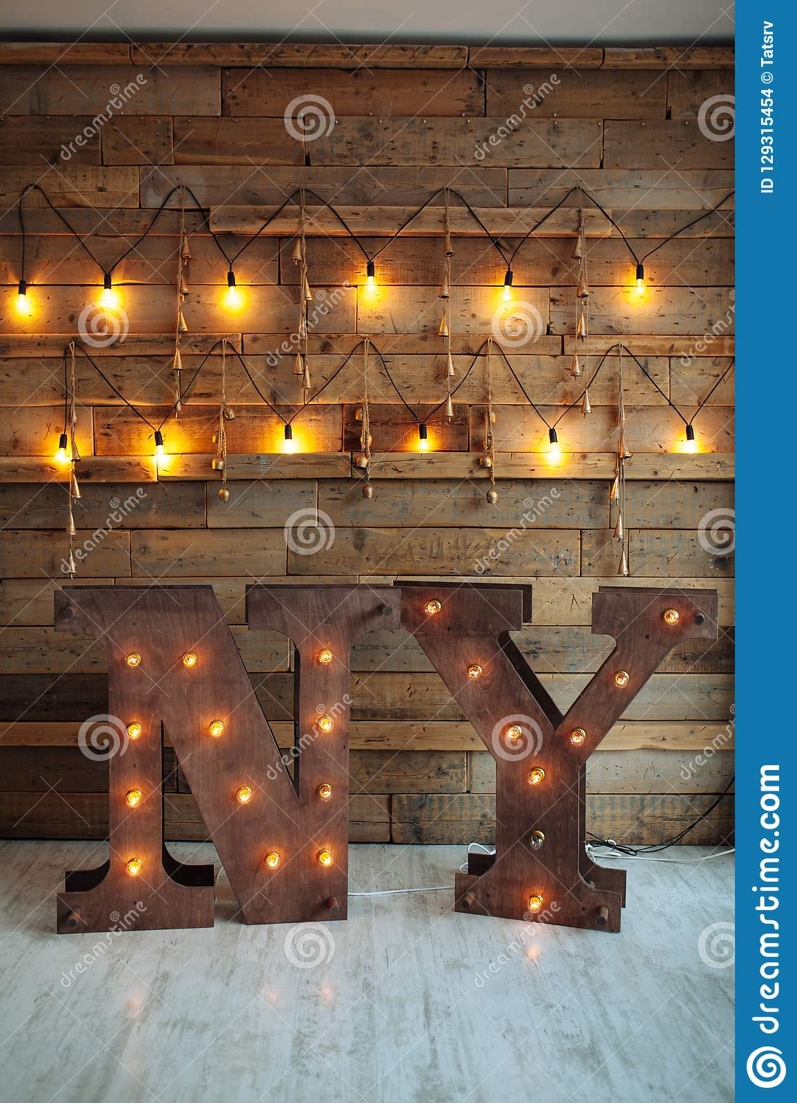 wooden letters ny with bulb lights on wooden wall background loft idea new year