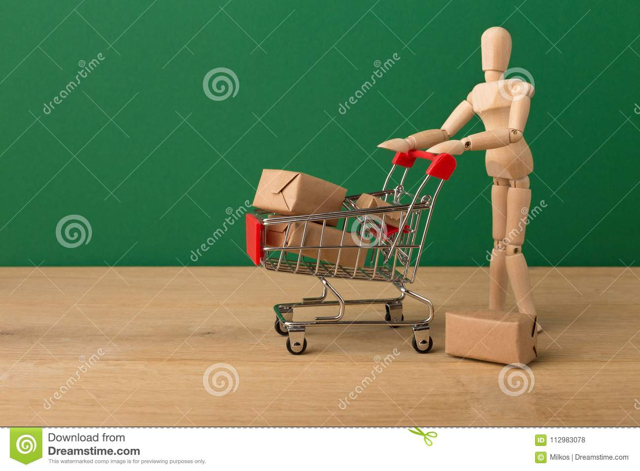 Wooden mannequin with miniature shopping cart
