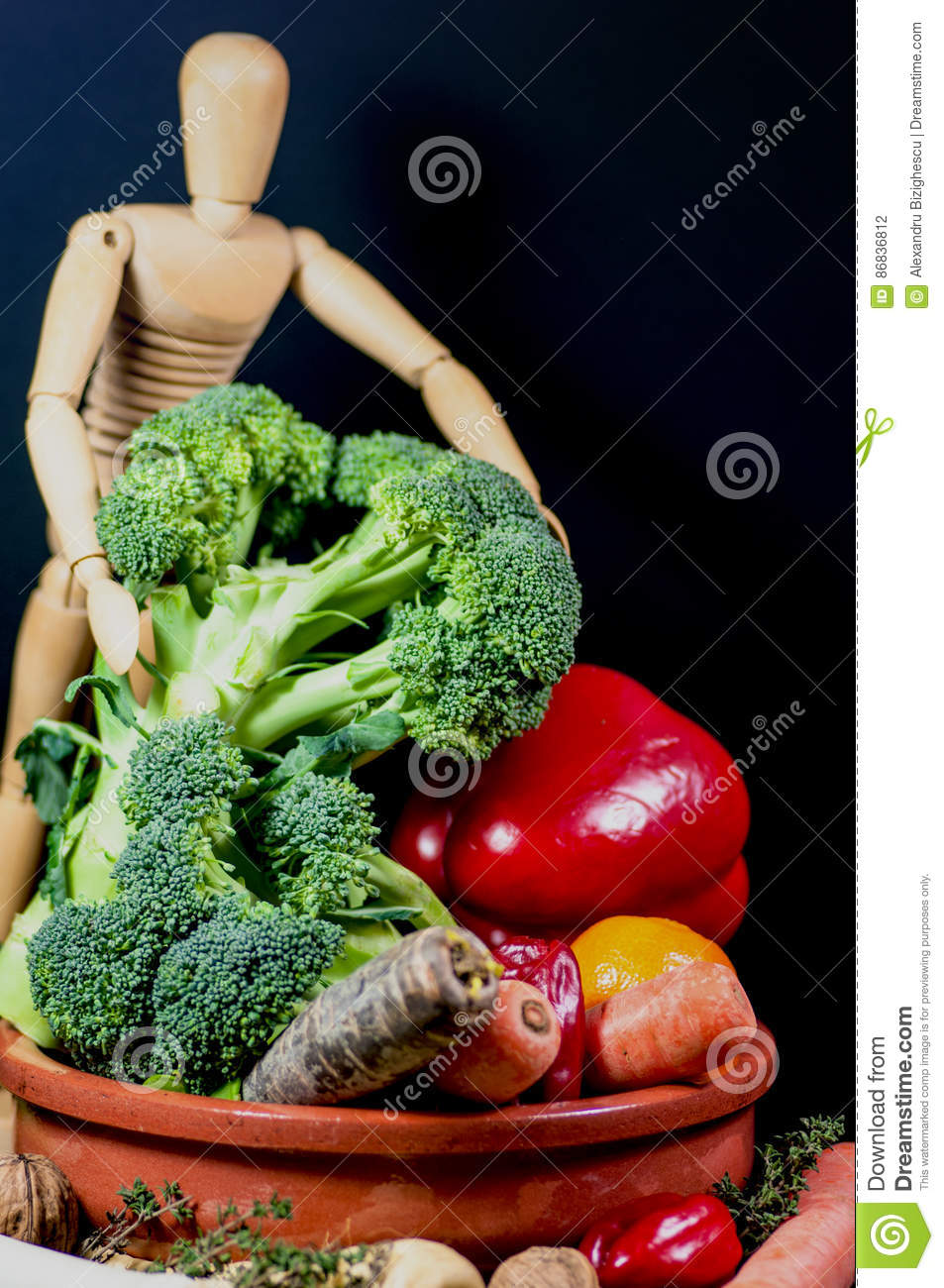 Wooden mannequin and a mix of vegetables