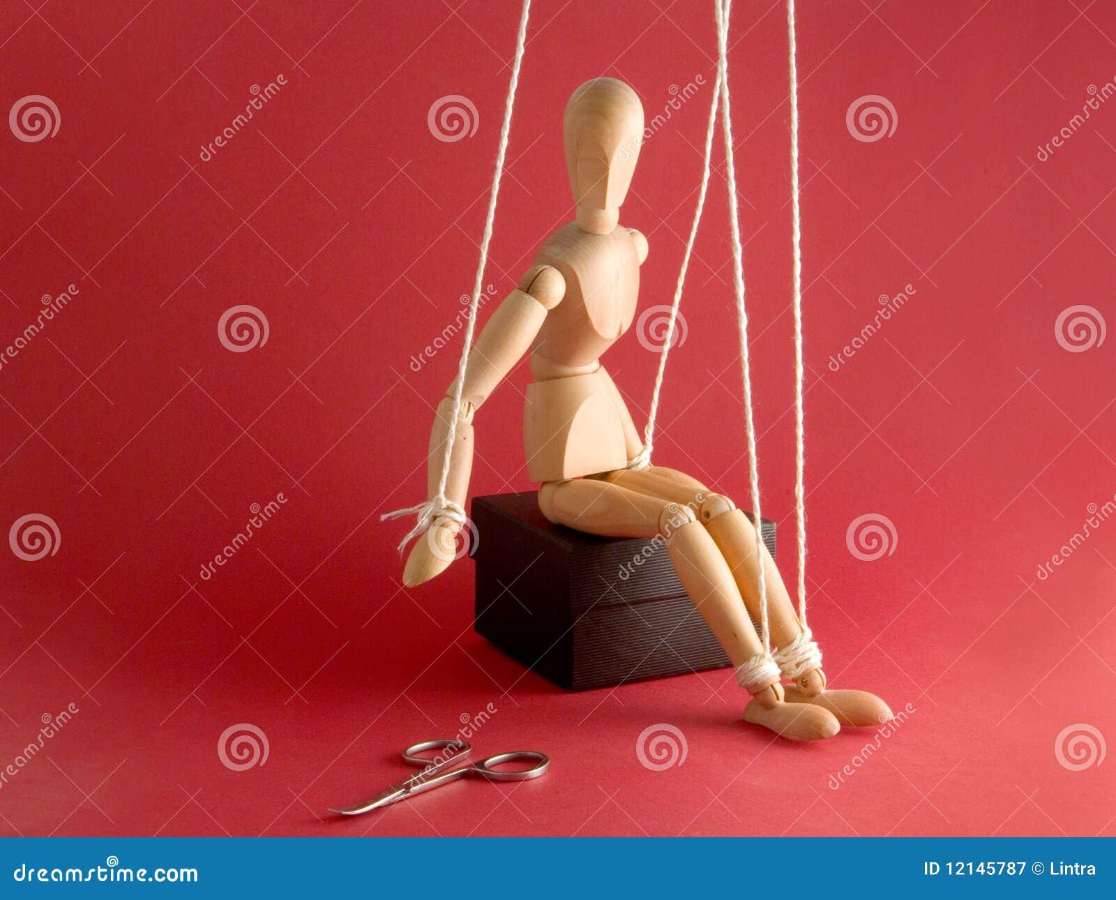 Wooden Mannequin and scissors