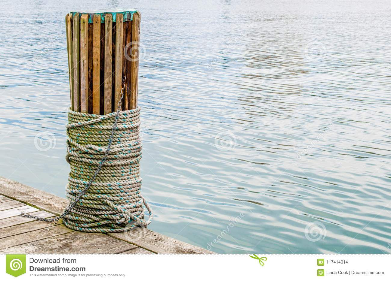 Wooden nautical batten with rope wrapped around it at the waterfront