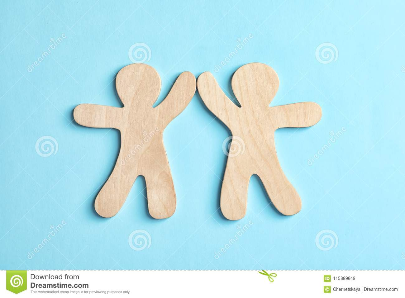 Wooden People Giving High Five On Color Background Stock