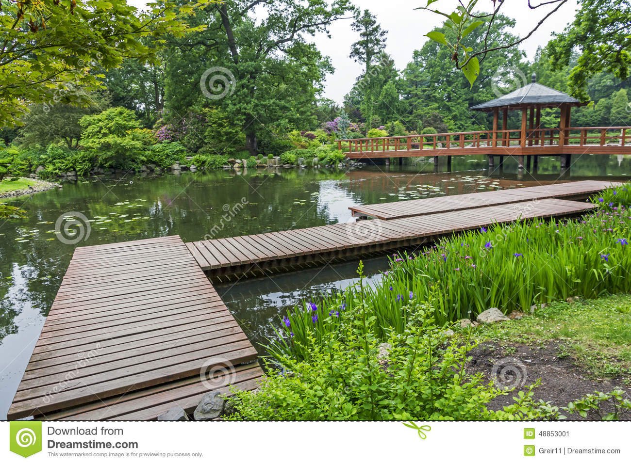 Japanese Garden Plants Wooden Pier And Beautiful Plants In A Japanese Garden Stock Photo