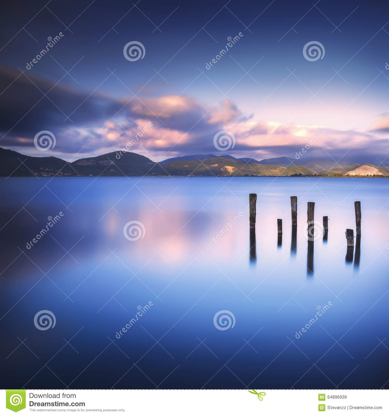 Download Wooden Pier Or Jetty Remains On A Blue Lake Sunset And Sky Refle Stock Image - Image of holiday, scene: 64896939