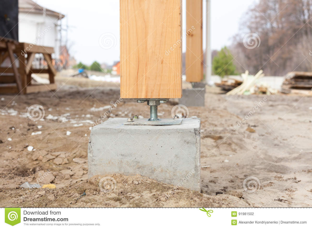 Wooden pillar on the construction site concrete with screw for Post and pillar foundation