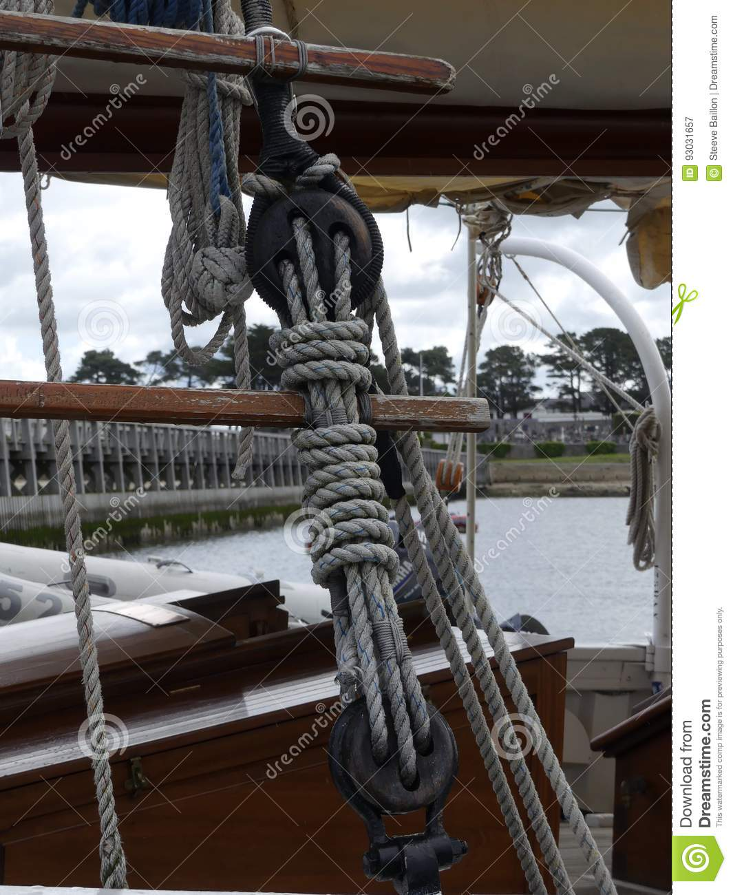 Wooden pulleys and ropes on vintage sailing boat