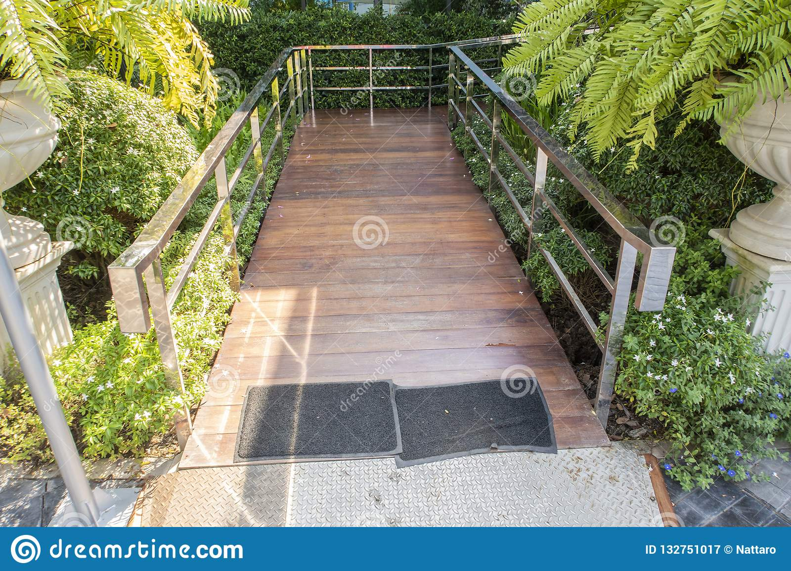 Wooden ramp way for support wheelchair disabled people in to coffee shop.