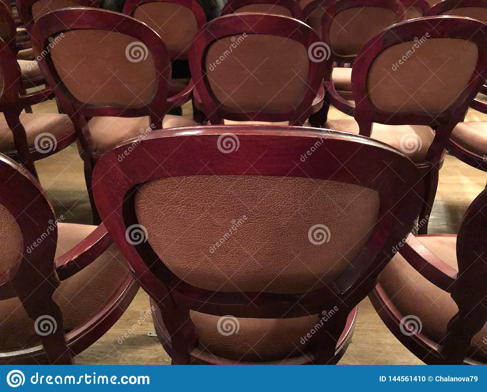 Wooden retro seats for spectators in the theater or cinema