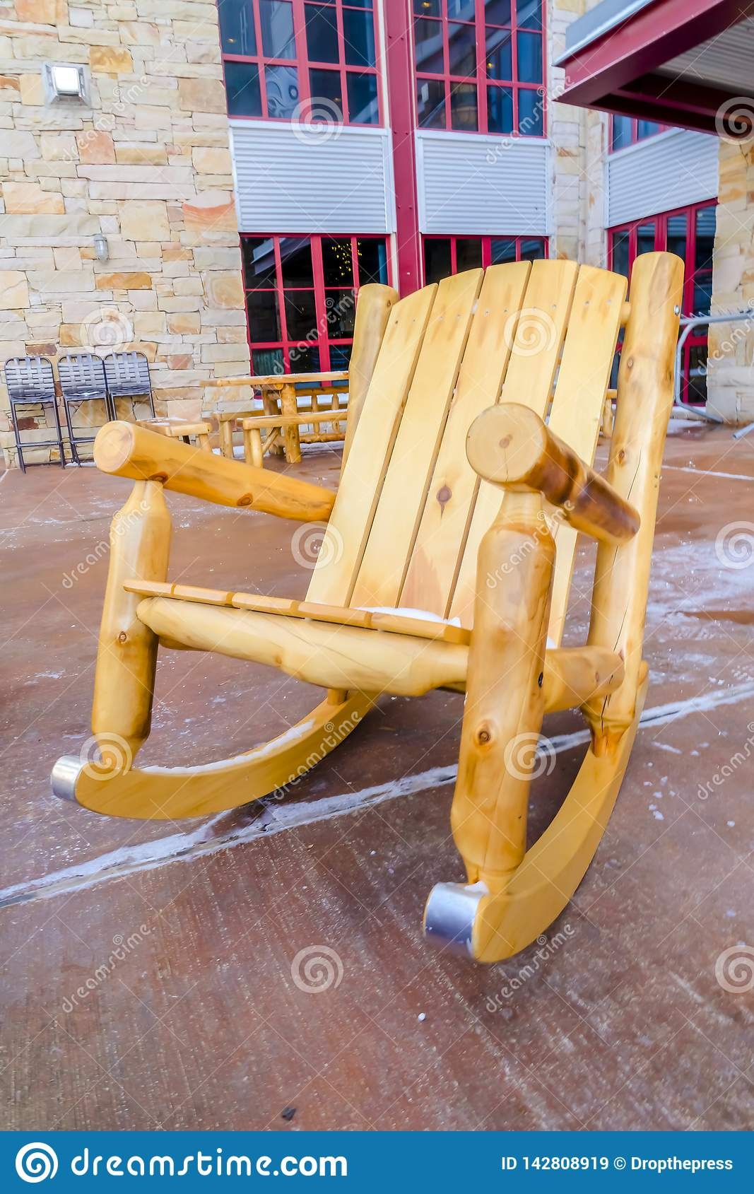 Astounding Wooden Rocking Chair On The Patio Of A Building Stock Image Bralicious Painted Fabric Chair Ideas Braliciousco
