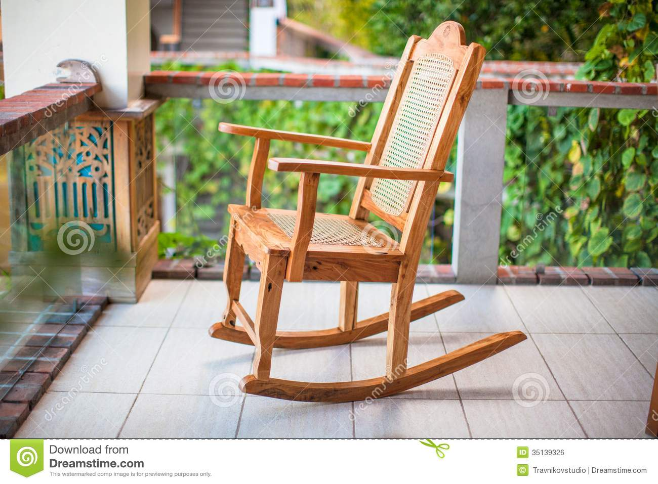 wooden rocking chair on the terrace of an exotic royalty free stock image image 35139326. Black Bedroom Furniture Sets. Home Design Ideas