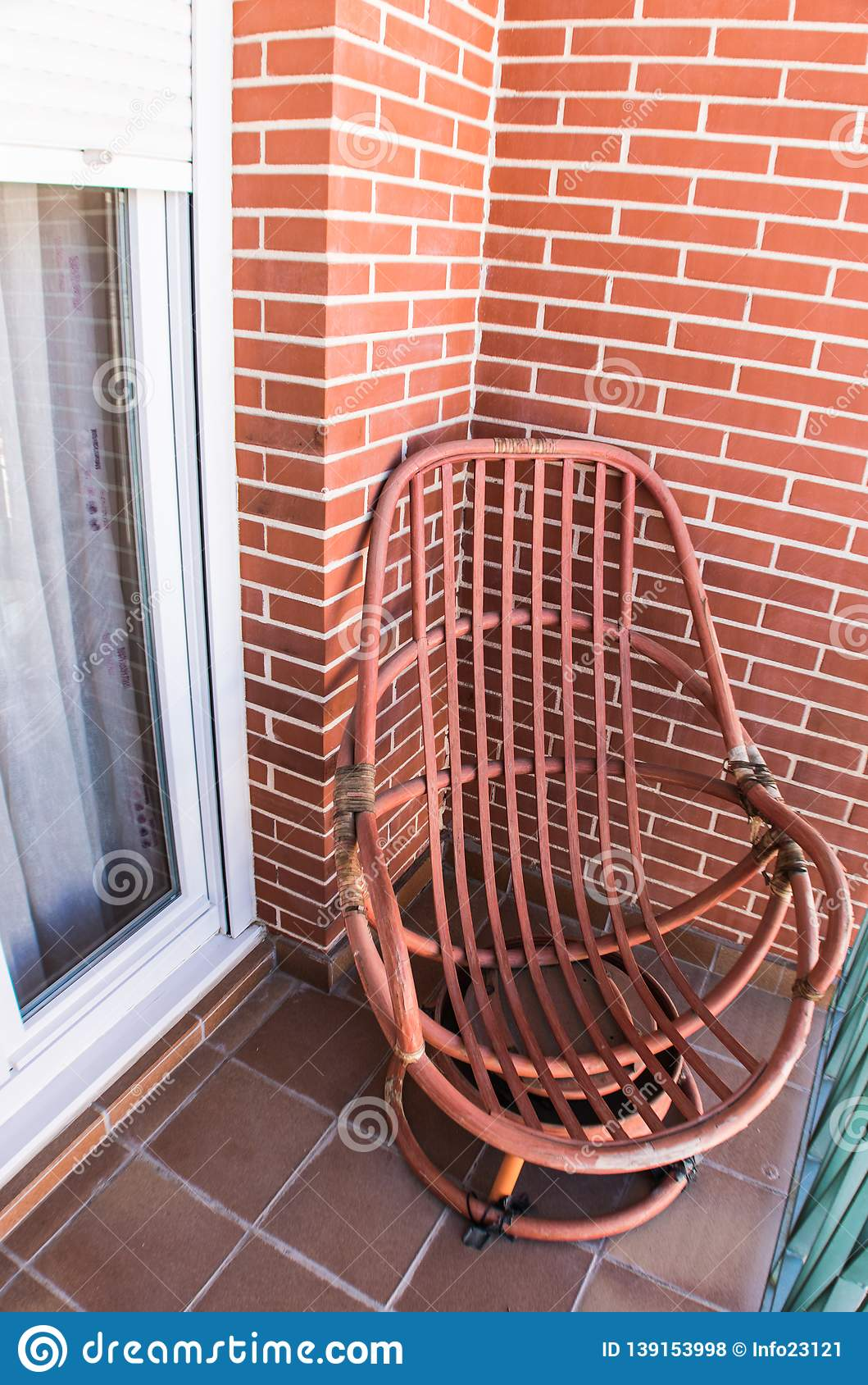 Wooden rocking chair on terrace