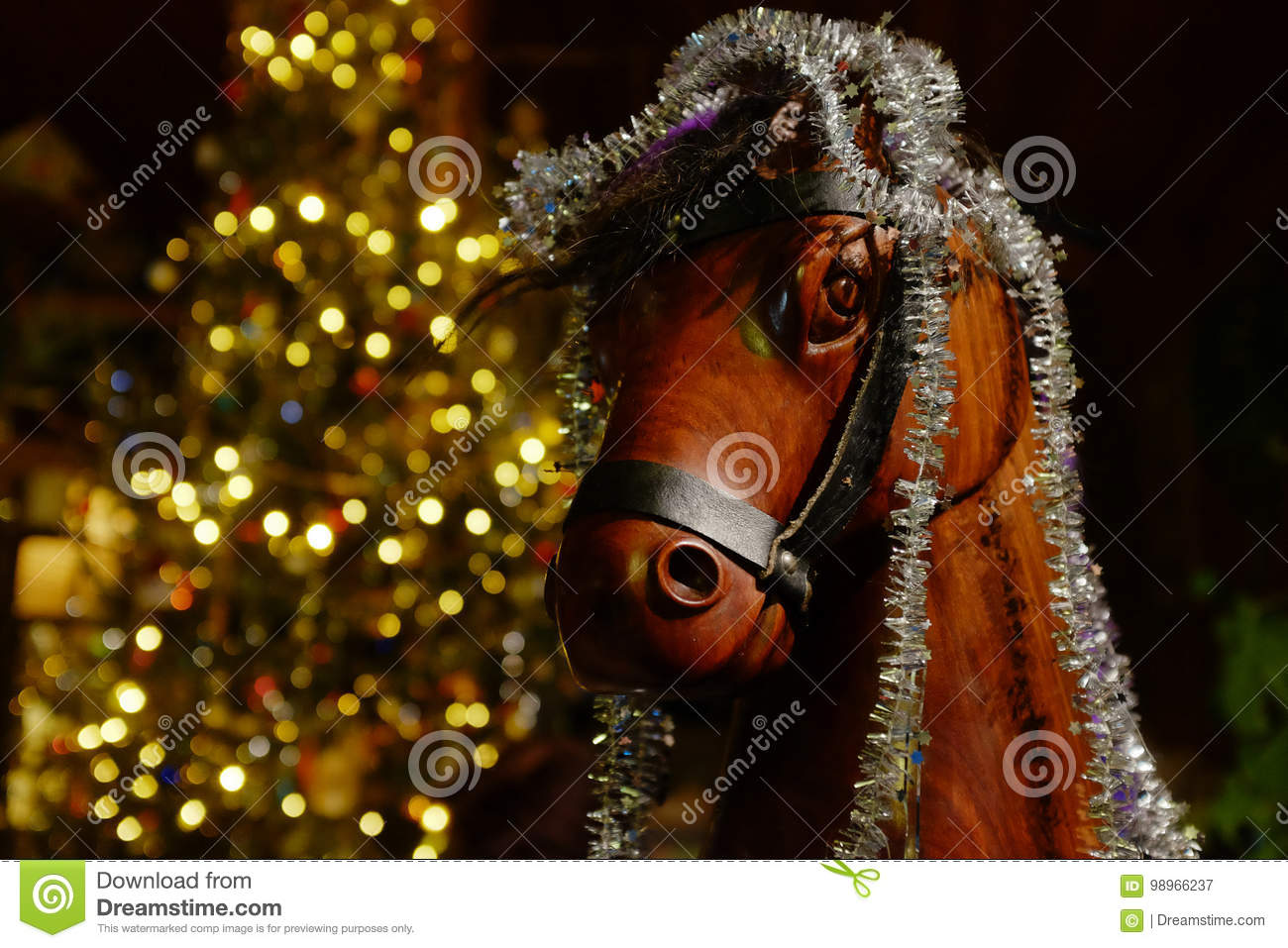 wooden rocking horse with christmas tree and decorations