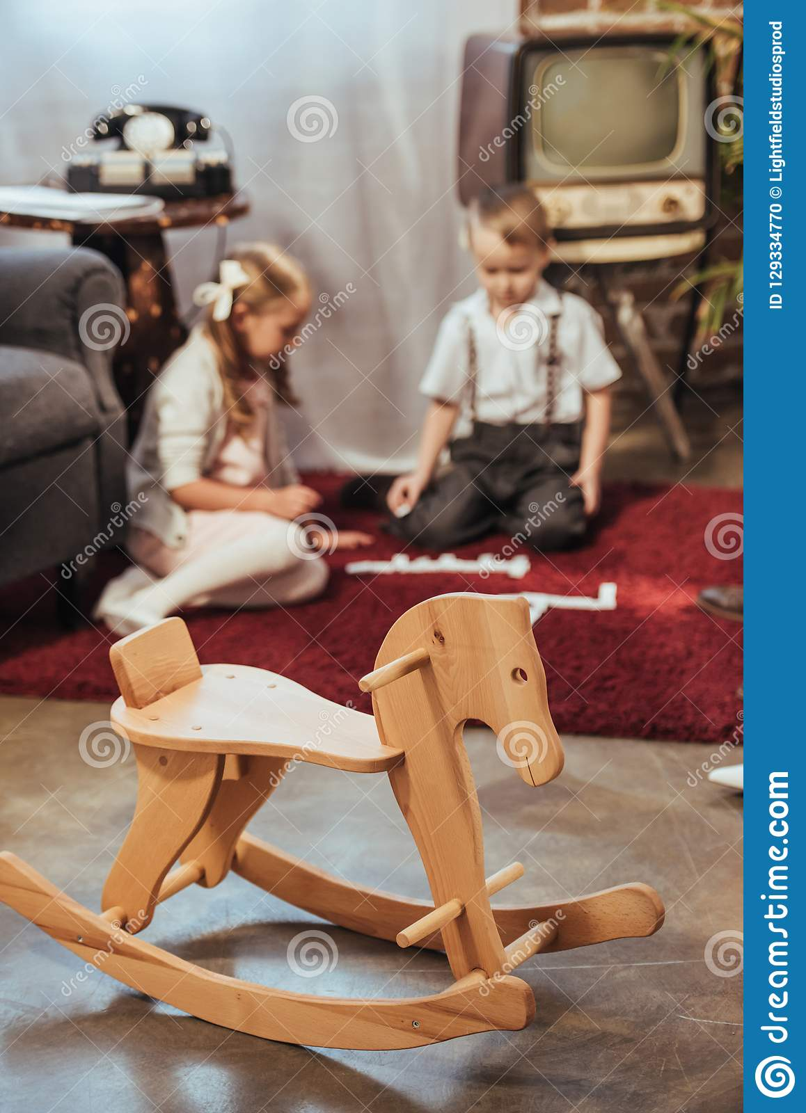 Wooden Rocking Horse And Little Kids Playing With Domino Tiles At Home Stock Photo Image Of Dominotiles Oldfashioned 129334770