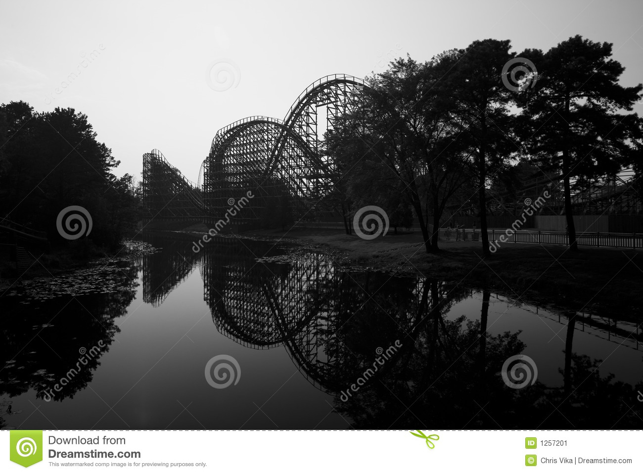 Wooden rollercoaster, trees and a lake