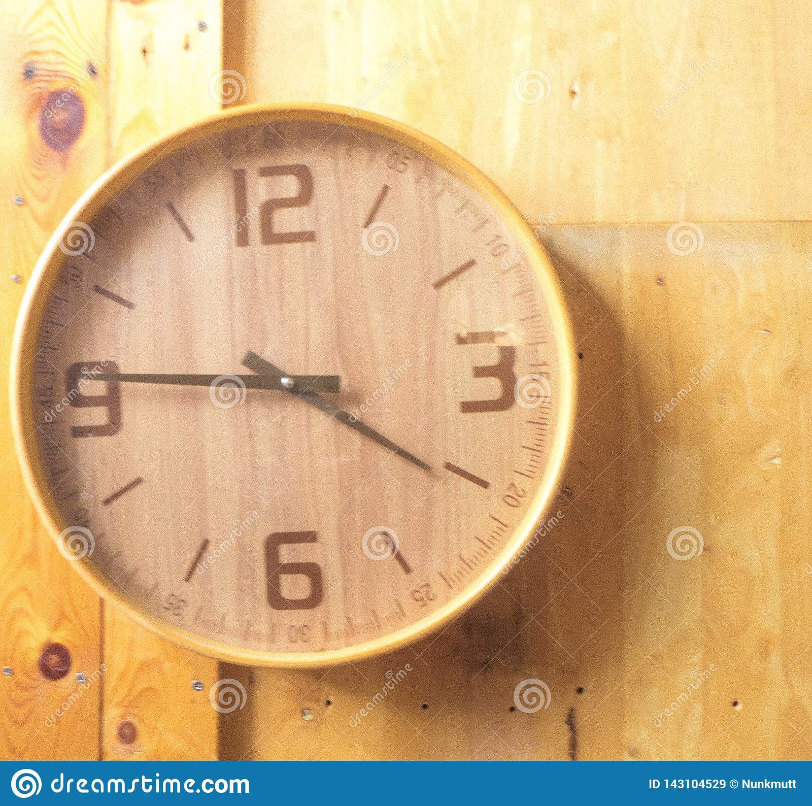 Wooden round wall watch - clock on wooden background eco nature background