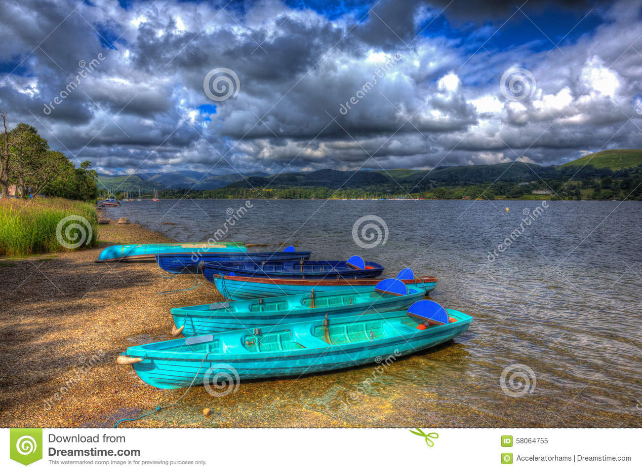 Wooden Rowing Boats By Lake With Mountains And Blue Sky ...