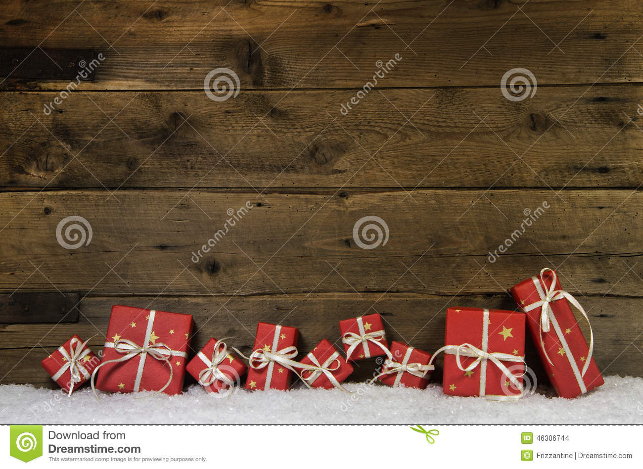 Wooden Rustic Background With Red Christmas Presents Stock Photo