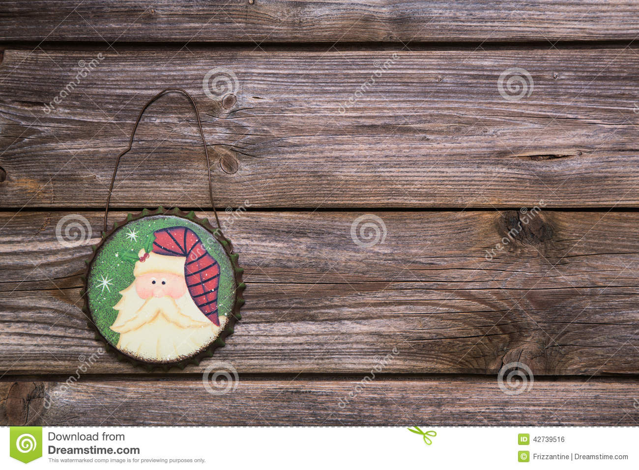 Wooden rustic and vintage christmas background with a hanging pa