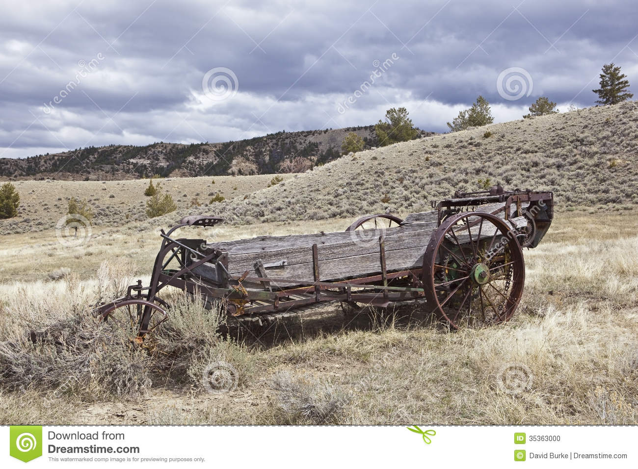 Wooden rusty agricultural manure spreader stock photo