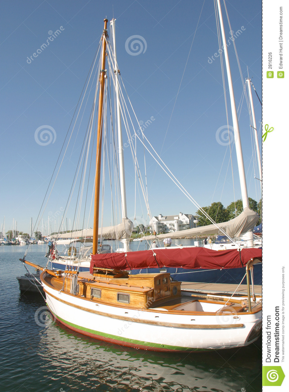 wooden sailboat at the dock.