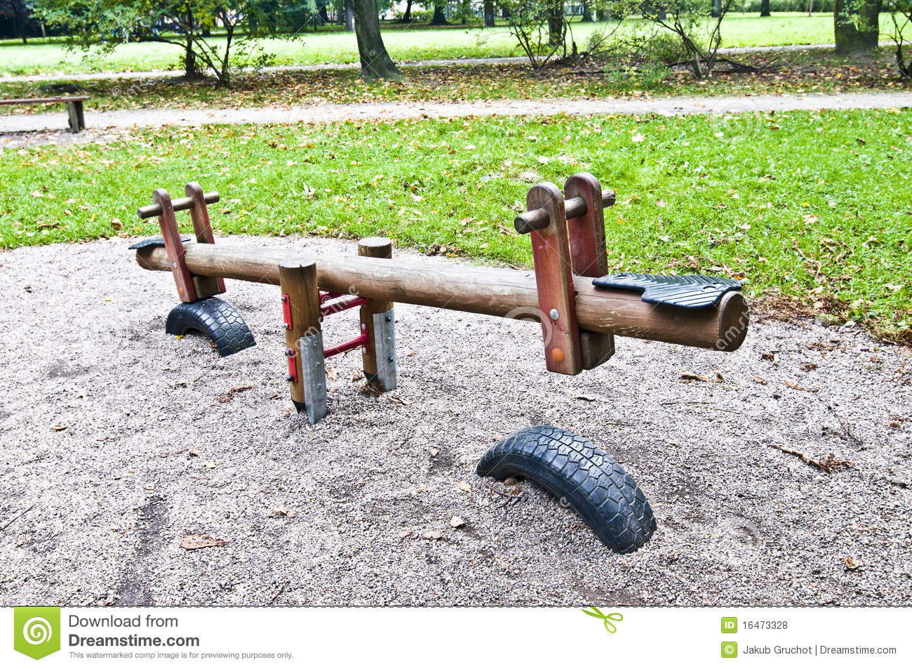 Wooden seesaw in the park playground royalty free stock for Seesaw plans designs