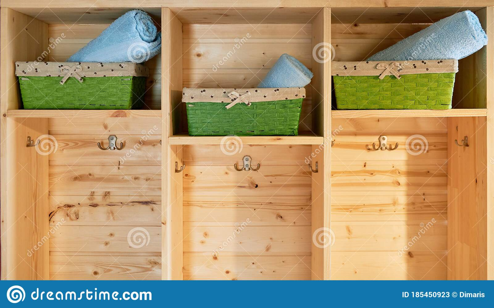 Wooden Shelving Unit And Baskets With Clean Towels Stock Image Image Of Folded Bath 185450923
