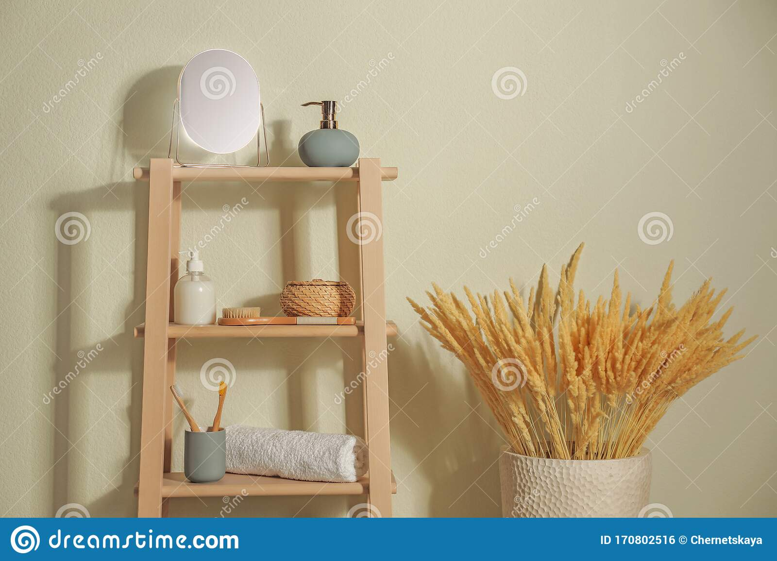 Wooden Shelving Unit With Toiletries Near Light Wall Indoors Bathroom Interior Element Stock Photo Image Of Bathroom Furniture 170802516