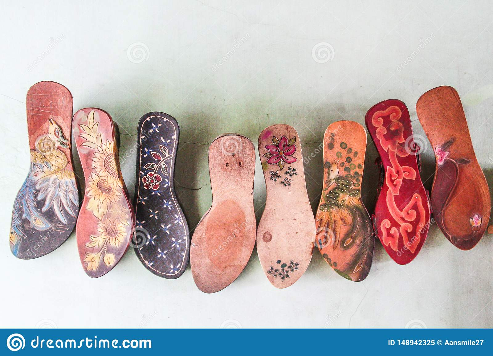 Asian traditional painted wooden shoe soles