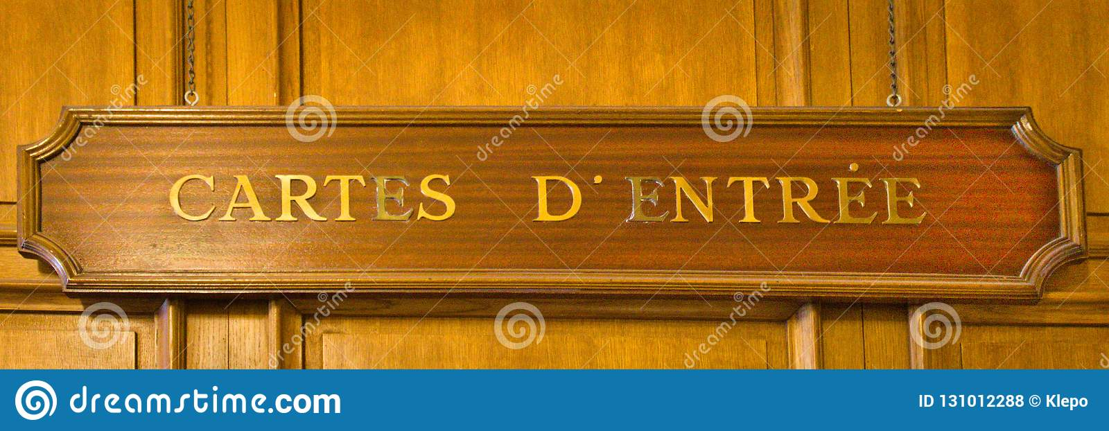 A wooden cartes d`entree sign