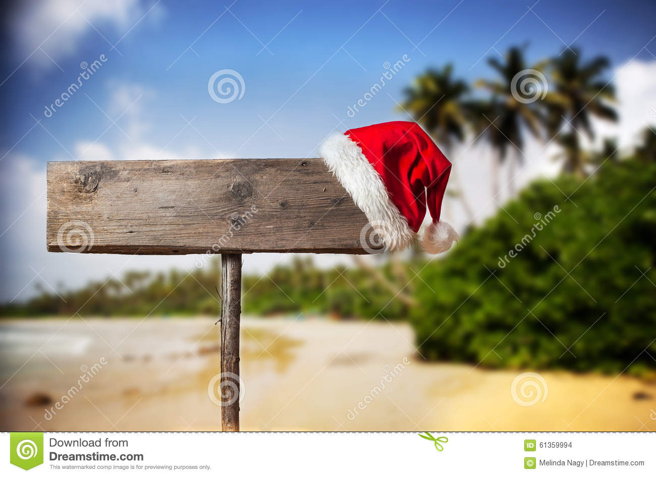 Wooden signboard with Christmas hat