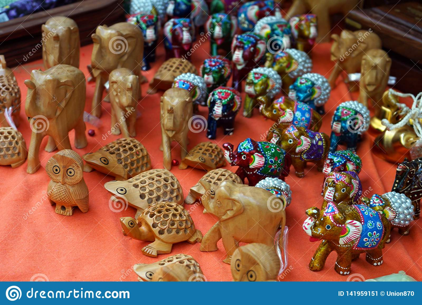 Wooden Small Figurines Of Various Animals On The Counter Of A Street