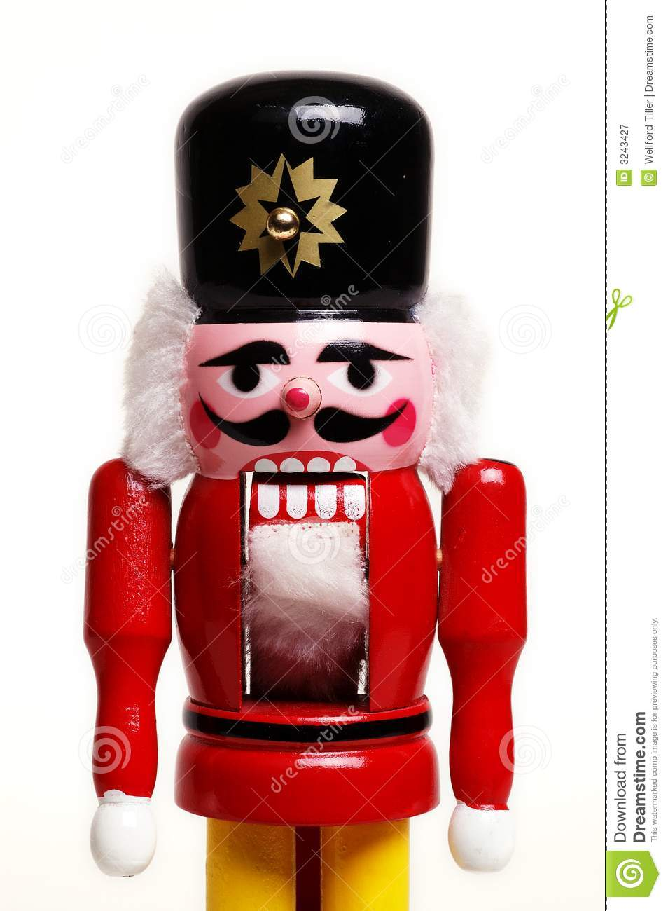 Old style wooden nutcracker in the shape of a soldier isolated on ...