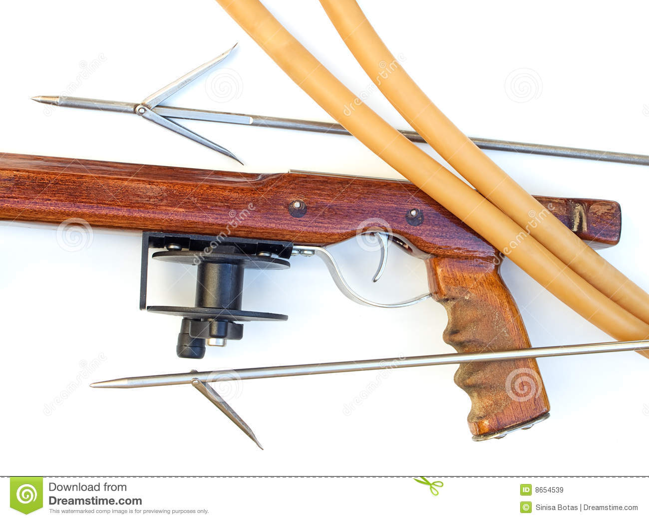 Handmade wooden speargun with equipment on a clear background.