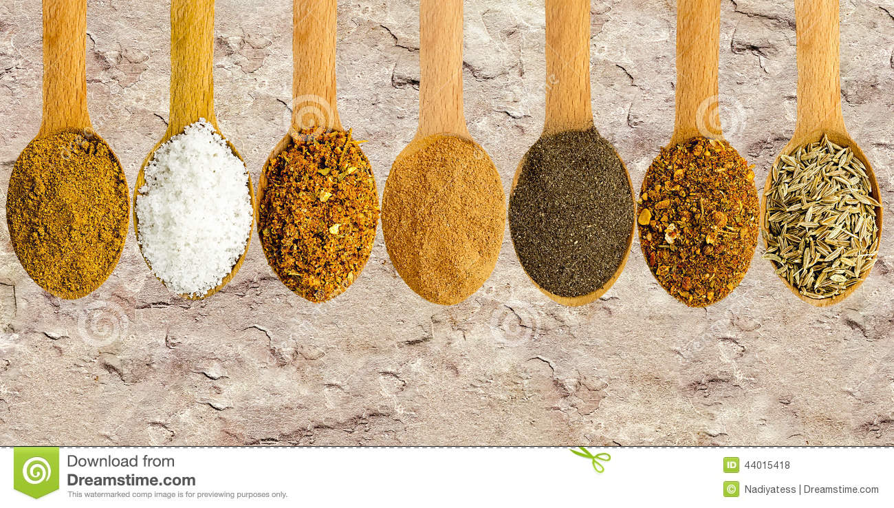 Wooden spoons with spices