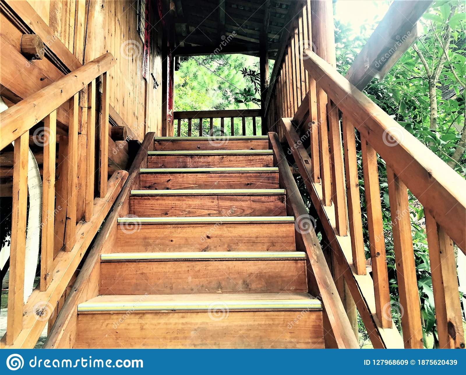 The wooden staircase made entirely by hand by Chinese minorities