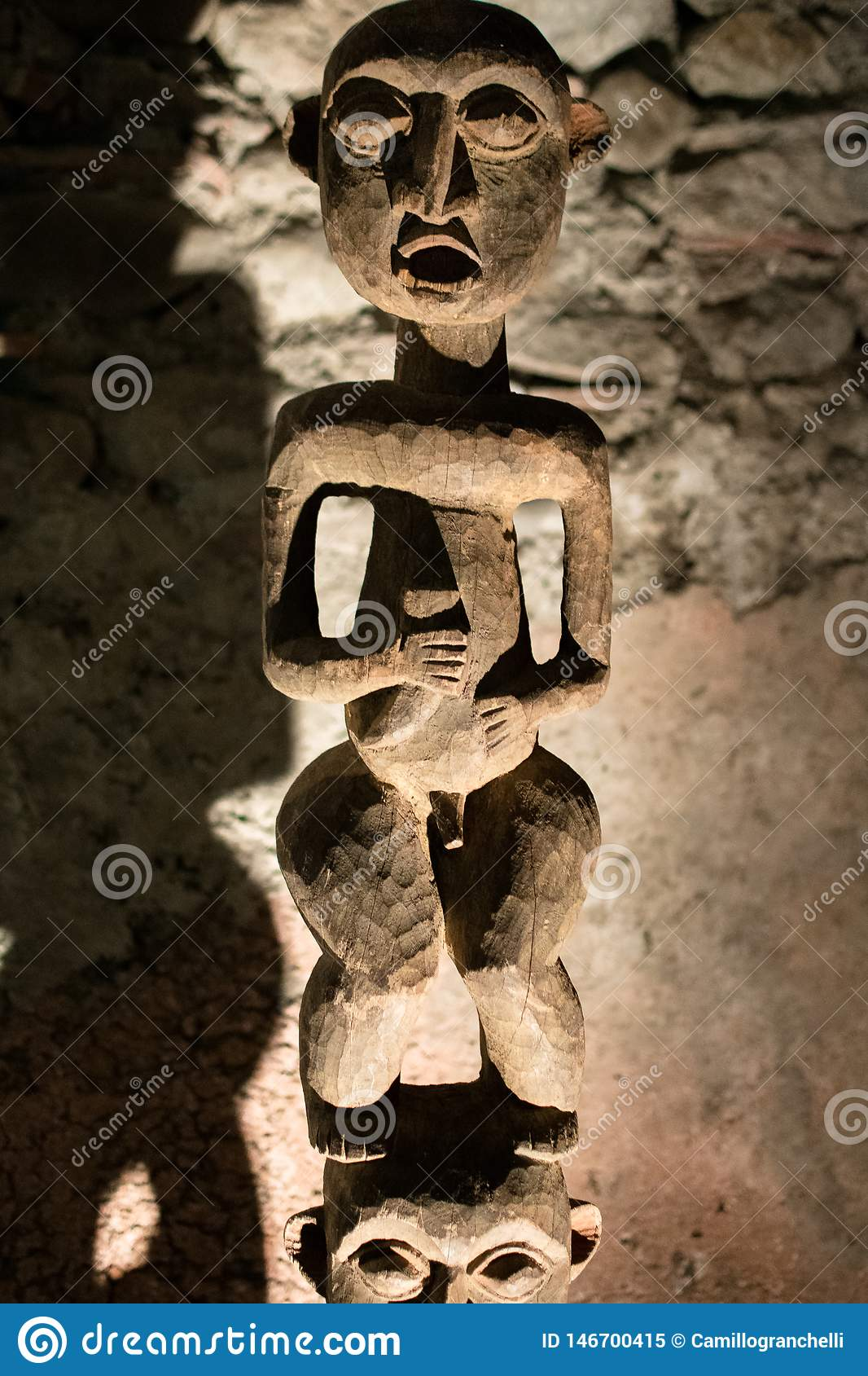 Wooden statue carved by primitive peoples