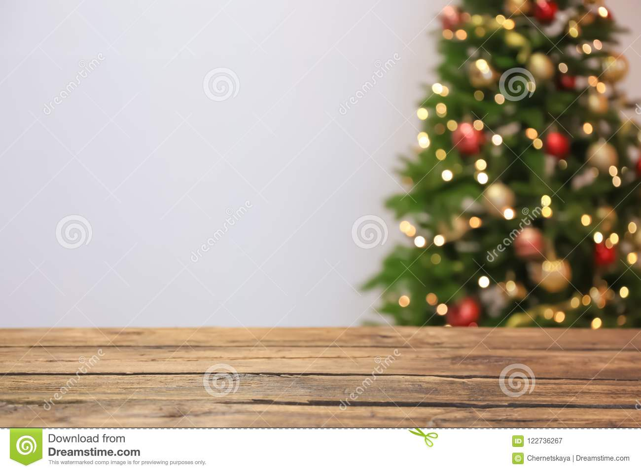 Wooden table and blurred Christmas tree